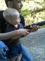Aiden learning about guns with Josh
