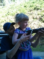 Savanna with Josh learning about the rifle
